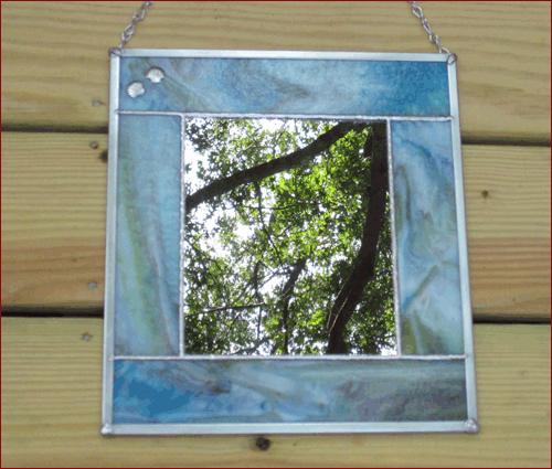 blue-green mirror with shells